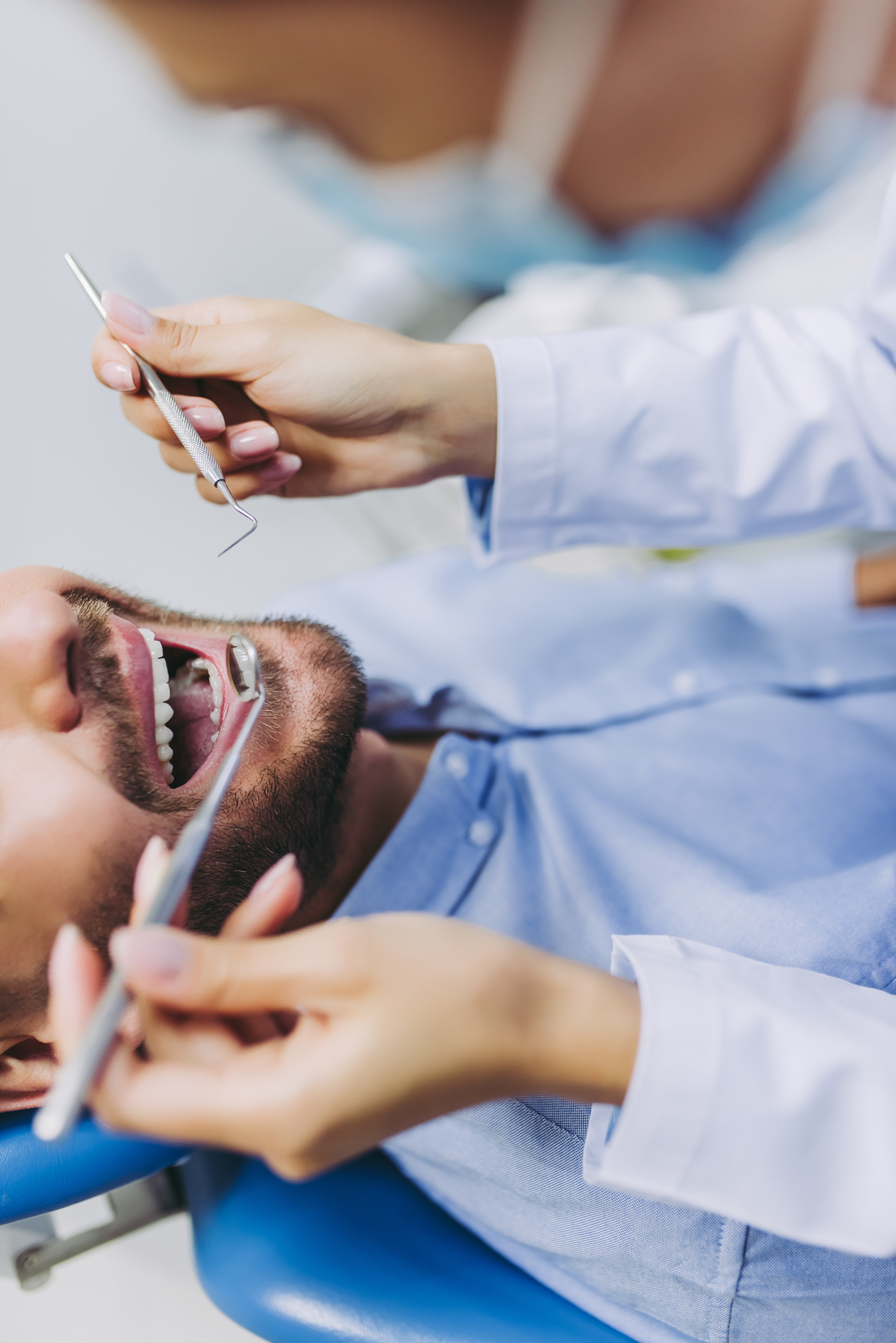 doctor checking patient teeth
